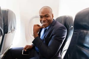Man on a plane in his seat